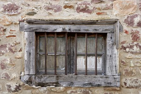 Aged wooden window in masonry stone walls house in Navarra Pyrenees Spain photo