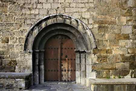 Ancient stone arch romanic architecture church in Spain Pyrenees photo