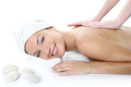 Beautiful spa blue eyes woman having massage over white background photo