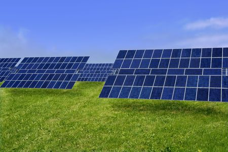 clean  electric: Clean electric energy solar plates generators in a green meadow Stock Photo