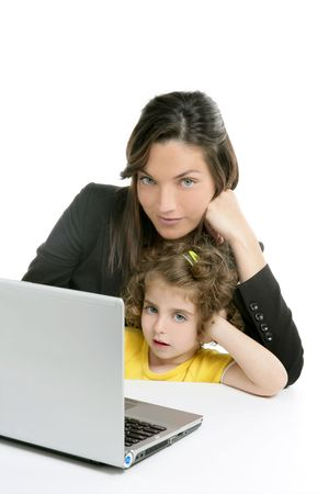 Beautiful mother and daughter with laptop computer on white background photo