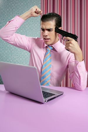 businessman young shooting handgun with computer pink bacground Stock Photo - 5897898