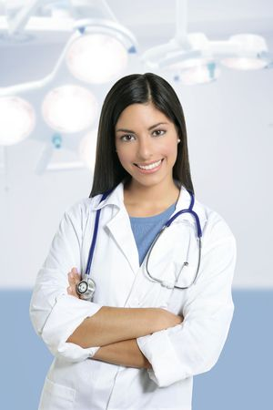 Beautiful brunette indian young happy doctor woman on surgery hospital photo