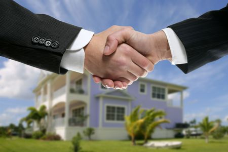 house in hand: Businessman teamwork real state house partners shaking hands handshake