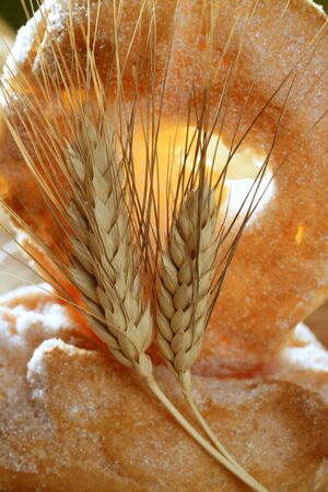 Delicious roll bakery with sugar and wheat ear spikes photo