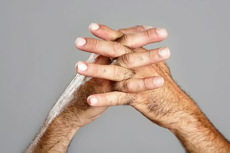Hairy man hand closeup expression over gray background Stock Photo - 5965035