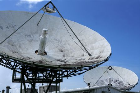 telecast: Parabolic satellite dish space technology receiver over blue sky Stock Photo