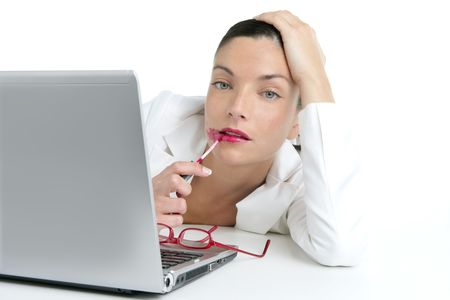 Business woman with red lipstick using laptop screen as a mirror photo