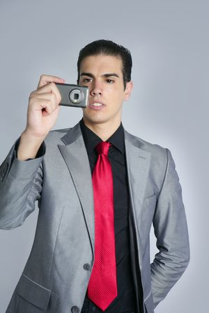 Businessman with gray suit taking photos with phone camera photo