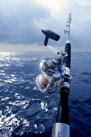 Big game boat fishing in deep sea on boat
