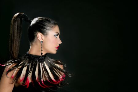 adult indian: Brunette from India profile fashion portrait with feathers
