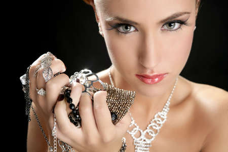 Ambition and greed in fashion woman with jewelry in hands on black background Stock Photo - 5993892