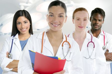 Doctors team group in a row on white background men and women doctor photo