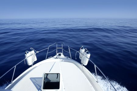 boat deck: Boat on the blue Mediterranean Sea yachting on a calm ocean Stock Photo