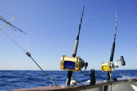 fishing tackle: Angler boat big game fishing in saltwater ocean