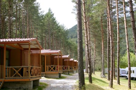 Forest wooden cabins in a mountain pine camping Pyrenees Stock Photo - 6077348
