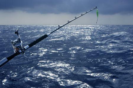 Big game boat fishing in deep sea on boat photo