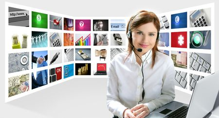 helpdesk: Business redhead beautiful woman headset micro headphones tech helpdesk Stock Photo