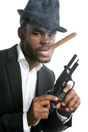 African american mafia man smoking cigar with handgun portrait photo