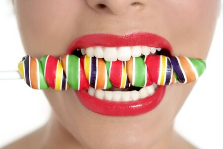 Colorful Lollypop in perfect woman teeth and red lips mouth Stock Photo - 6077088