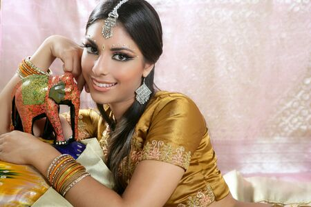 Beautiful indian brunette portrait with traditional costume photo