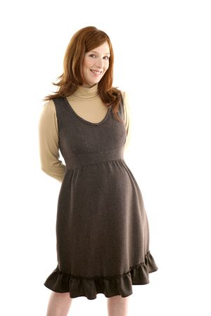 Beautiful pregnant redhead woman fashion white background photo