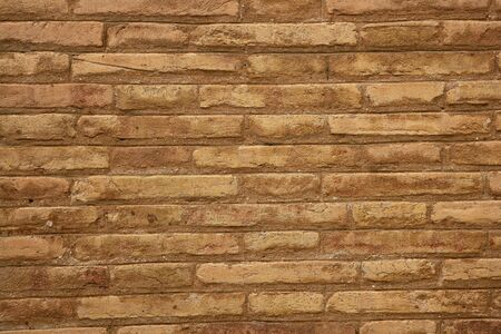 Brown brick wall in cream beige color pattern background photo