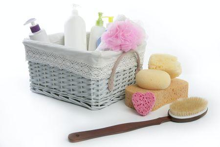 Bath toiletries basket with shower gel shampoo sponge and towel  photo