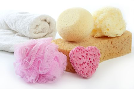 Toiletries stuff sponge gel shampoo and bath towels on white background photo
