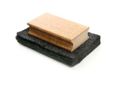 Chalkboard cleaner sponge for blackboard chalk isolated on white photo