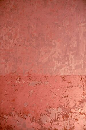Aged grunge wall pink texture scraped old paint interior photo