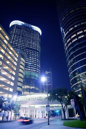 Blue night city lights and buildings in Houston downtown Texas photo