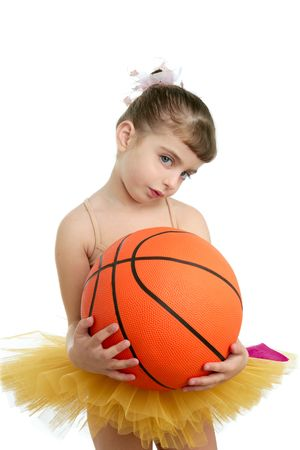 Ballerina little girl with basketball orange ball in her hands photo