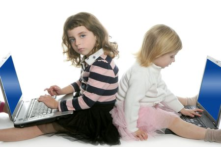 two little girls sister studying computer laptops at school    photo