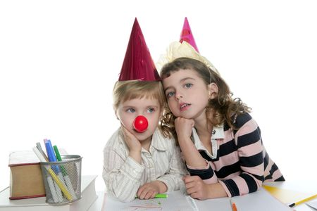 Party student two little girls with hat and clown nose Stock Photo - 6321085