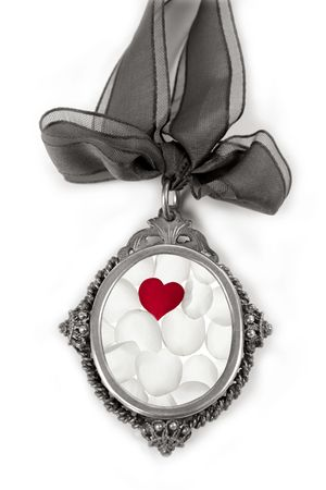 Cameo silver locket with petals red valentines heart isolated on white photo