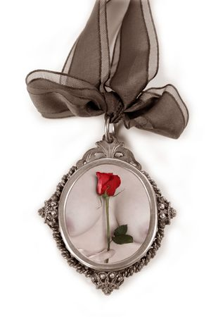 Cameo silver locket with valentines red rose on nude woman hands photo