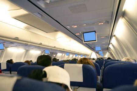 Airplane with passengers interior view  photo