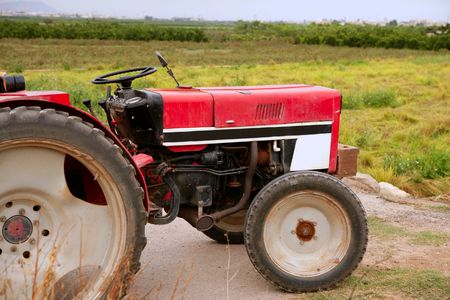 Agriculture aged red tractor  retro vintage machine Stock Photo - 6350480
