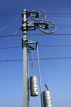 Cables and pole tower, electric train railway photo