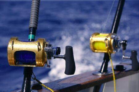 sportfishing: Angler boat big game fishing in saltwater ocean