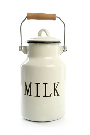 Milk urn white pot traditional farmer style isolated on white photo