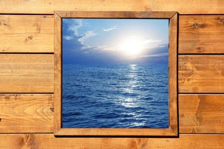 window display: Window seascape view from wooden frame room