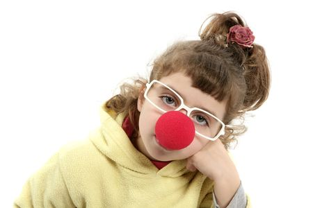 sad clown nose little girl with big glasses posing portrait on white    photo