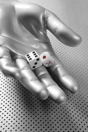 Dices gambling futuristic metaphor in silver aluminum hand photo