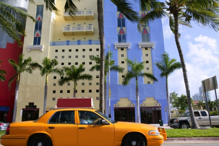 Yellow cab with Miami Beach Florida buildings photo