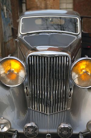 spoiler: Car vintage,  in silver color, yellow headlights