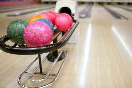 Bowling colorful balls and wooden floor perspective  photo