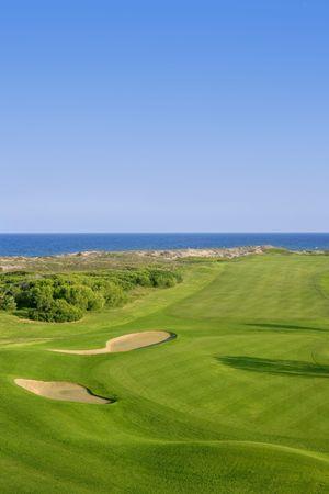 golf landscape: Golf course green grass, sea ocean and summer blue sky