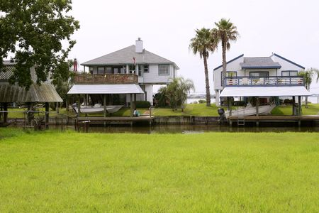 American houses in south Texas green grass river and boats Stock Photo - 6386235